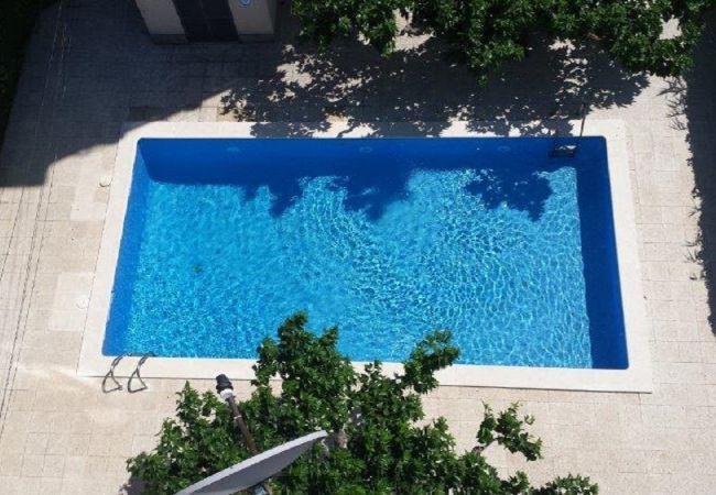 in Rosas / Roses - ISAR25-Apartamento con piscina comunitaria